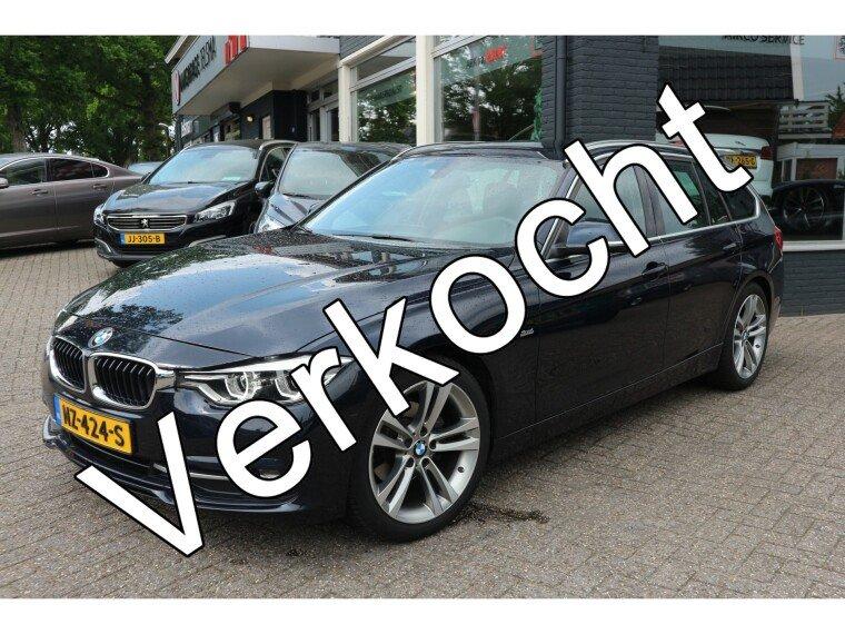 Foto van BMW 3 Serie Touring 320d EDE High Executive Sport-line,